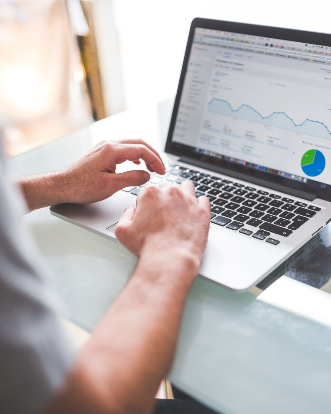 Paid Media Agency - Brick Media - Computer Showing Data and Charts
